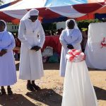 The First Sisters to work in Tikit mission being presented by a member of the General Council